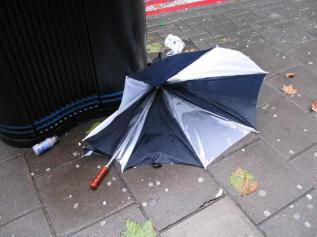 broken-umbrella-by-jon-jordan
